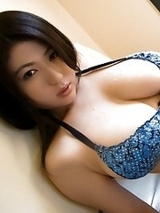 Nonami Takizawa Asian with generous boobs is erotic on the beach